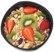 Muesli And Fruits In Bowl Isolated