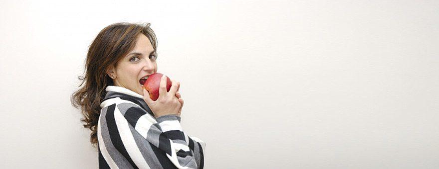 Woman Eating Apple - Image: Danilo Rizzuti / FreeDigitalPhotos.net